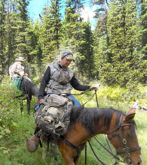 Paul riding during guided elk hunt